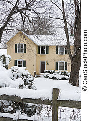 Yellow farmhouse in snow - Snowy landscape with yellow...