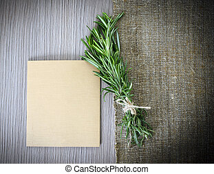 Rosemary Bound on a Wooden Board Background Lots of copy...
