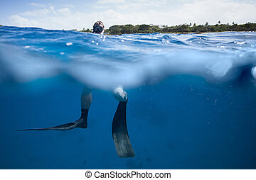 Freediver at the Surface of the Ocean in San Andres,...
