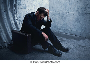 Very Desparate Businessman lying on the ground