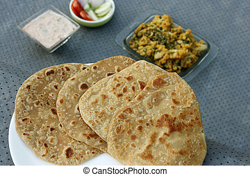 Tandoori Roti is an Indian unleavened bread - Tandoori Roti...