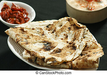 Tandoori Roti is Indian unleavened bread which is usually...