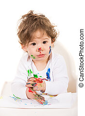 Amazed toddler boy with messy hands