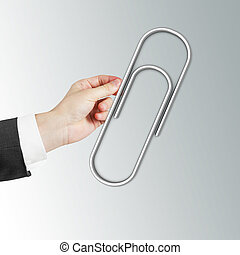 hand holding Paper clip on a white background