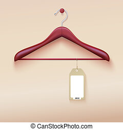 Wooden clothing hanger with tag isolated on cream background.