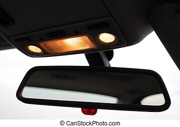 Car rearview mirror with indoors li - A close-up photo of...
