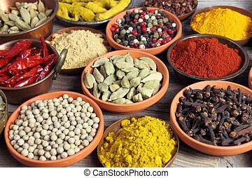 Spices - Colorful spices in ceramic and metal containers -...