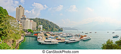 SUN MOON LAKE - OCT 25: many boats parking at the pier on...