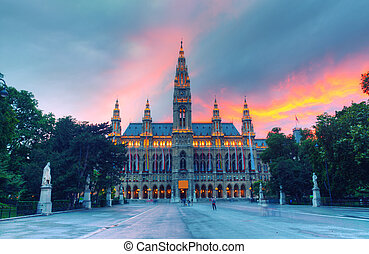 Tall gothic building of Vienna city hall in sunset, Austria