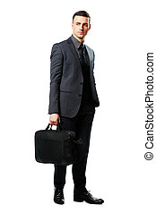 Full-length portrait of a confident businessman with bag...