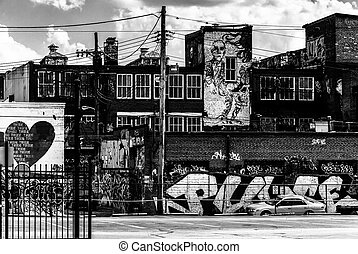 Graffiti and old buildings in Baltimore, Maryland. -...
