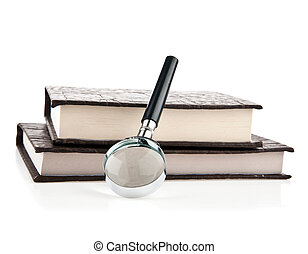 books and a magnifying glass