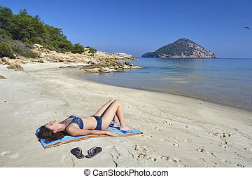 Paradise beach - Beautiful young woman enjoying the sunshine...