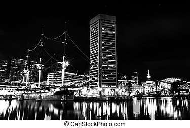 The USS Constellation and World Trade Center at night, in...