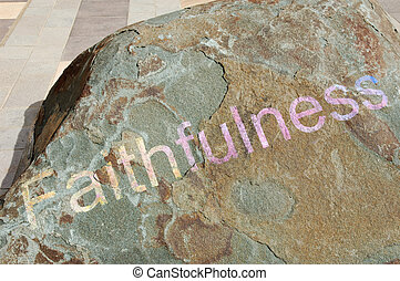 Faithfulness on stone background - Painted word Faithfulness...