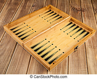 Board game of backgammon on a wooden table