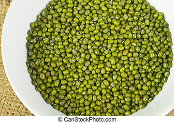 Green mung beans in white bowl
