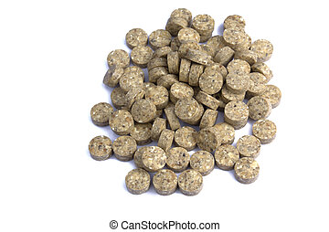 Heap of grassy tablets on a white background it is isolated