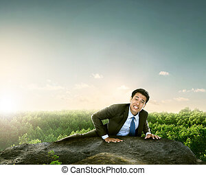businessman climbing mountain high - portrait of businessman...