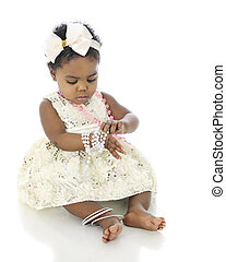 Beads on Baby - A beautiful baby girl all dressed up,...