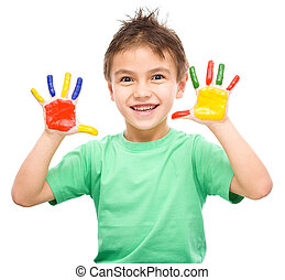 Portrait of a cute boy playing with paints - Portrait of a...