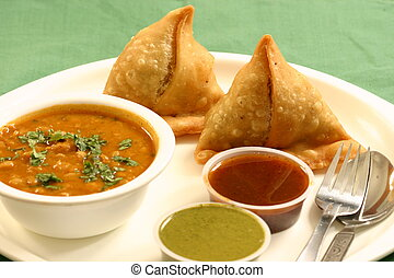 Samosa is an Indain fried or baked pastry with a savory...