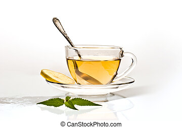cup of tea with leave of mint and lemon