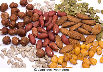 Nuts and seeds - Healthy snacks, nuts and seeds on white...