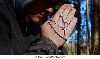 Religious man with a rosary