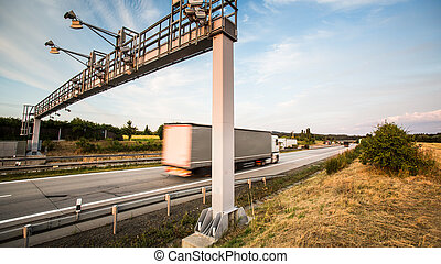 truck passing through a toll gate on a highway motion...