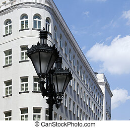 streetlamp - Ornate metal street lamp white building in the...