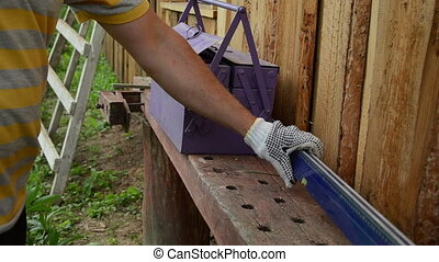 tool box hammer saw - man pulls out of the purple tool box...