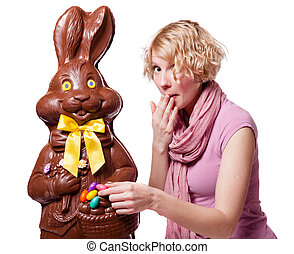 Blond Girl stealing Easter Eggs of a Chocolate Bunny...