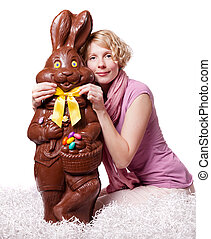 Blond Girl Adjusting Bowtie of a Chocolate Easter Bunny...