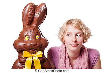 Chocolate Easter Bunny Looking at a Blond Girl - Chocolate...