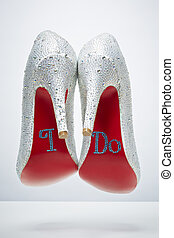 Bridal wedding shoes with I do message on sole isolated on...