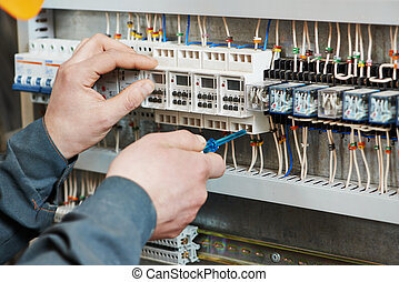 electrician work - Hands of electrician with screwdriver...