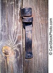 Old rust hinge in wooden door. - Old, wrought, damaged, rust...