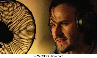 music fan in the dark