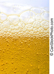 bubbles in beer or dishes soap shampoo close-up