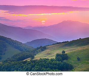 Colorful sunset in the mountains at the summer