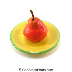 red pear - image of a red pear on a yellow plate