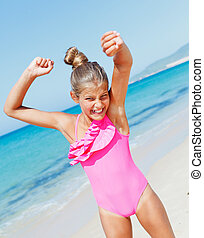Cute girl on the beach - Beautiful happy smiling girl having...