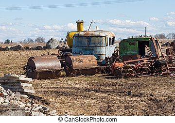 rusting farm machinery in a field - rusting farm machinery...