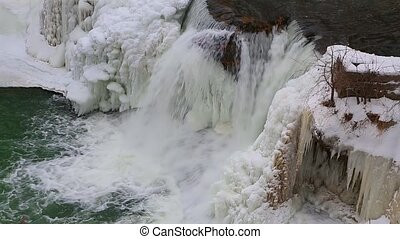 Icy Cataract Loop - Water splashes down a wintry, partially...