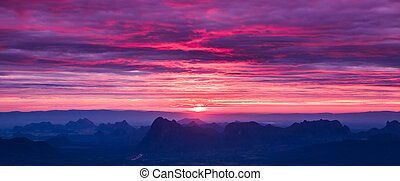 Beautiful winter sunrise in mountains and first light...