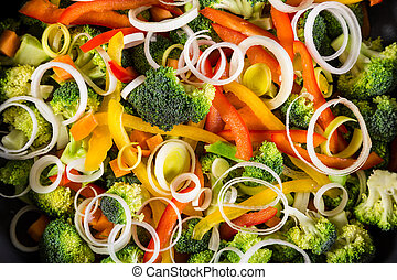 chopped vegetables in a frying pan - chopped raw vegetables...