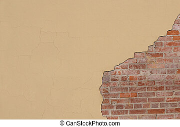 Cracked Stucco Wall with Bricks Exposed - Cracked cream...