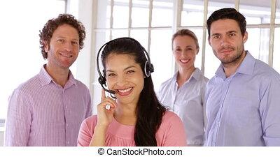 Young team posing smiling at camera