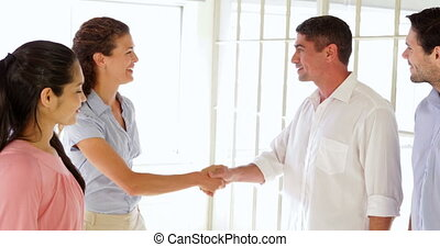 Attractive man welcoming young woman in the office